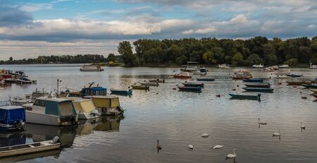 dinghies: Many small fishing boats anchored on Danube river with beautiful blue sky View from Zemun part of Belgrade Serbia Stock Photo