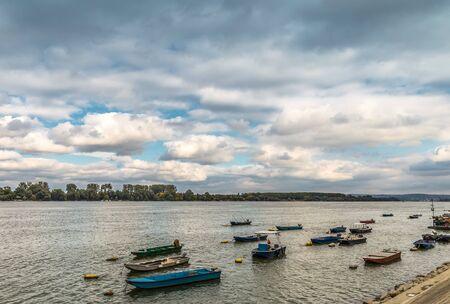 dinghies: Small fishing boat river Danube Belgrade Serbia with beautiful blue sky Stock Photo