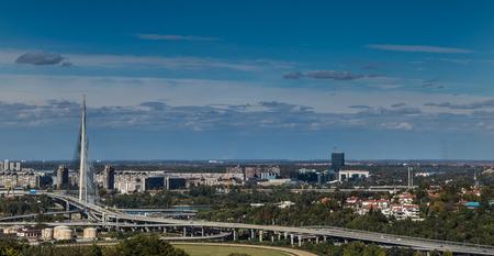 belgrade: View on the Belgrade and New Belgrade in background, Ada Bridge landmark with beautiful blue sky
