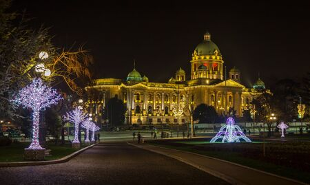 Abstract Christmas and New Year decoration parliament of republic Serbia with beautiful park Stock Photo