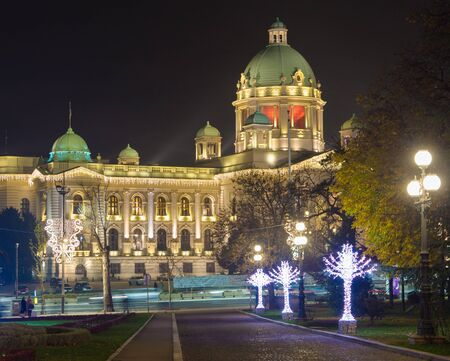 Abstract Christmas and New Year decoration parliament of republic Serbia with beautiful park Belgrade Stock Photo