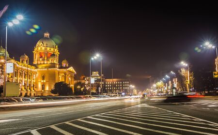 lon: Parliament of the Republic of Serbia in Belgrade at night long exposure trafic light Stock Photo
