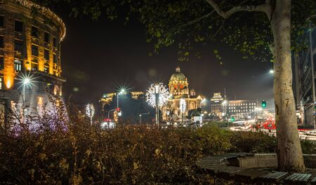 Night scene along the Nikola Pasic square with NewYear decorations, violet fountain and assembly of the Republic Serbia, long exposure photo Stock Photo