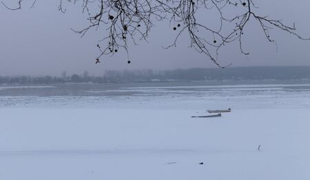 lido: Frozen river Danube at -15C, with two small fishing boats