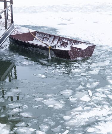 trapped: Small fishing boat trapped in ice on frozen river Danube