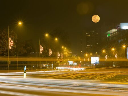 New Belgrade street at night, long exposure photo with beautiful moon Stock Photo