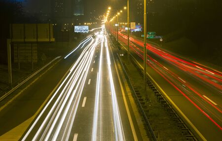 Driving on highway at night Belgrade - Serbia. Light trails on motorway at night of full moon, long exposure abstract photograph