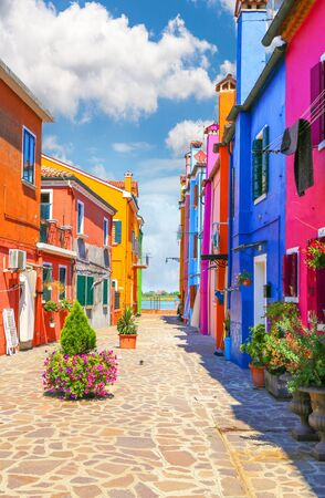 streetlife: Venice, landmark, Burano island, canal, colorful, houses, italy, with fantastic sky in background Stock Photo
