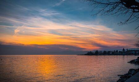 leman: Sunset over the lake Leman, city of Lausanne, Switzerland, vignette effect