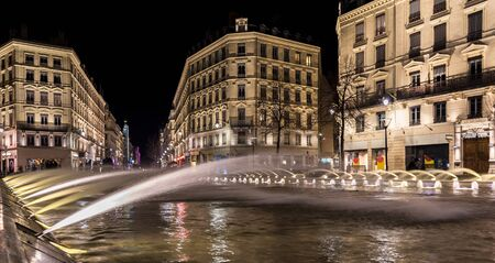 Down town Lyon France view on the beautiful fountain at night. Long exposure photography Stock Photo