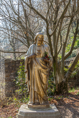 relic: Outdoor Statue of Jesus in the beautiful park near the Basilica of Notre-Dame de Fourviere