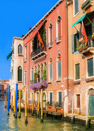 View on canal, many multicolored houses and beautiful blue sky Venice, Italy Stock Photo