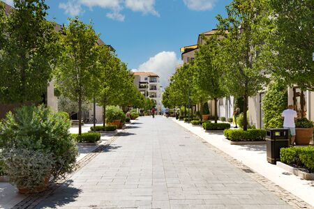Street in Porto Montenegro with beautiful summer sky, promenade