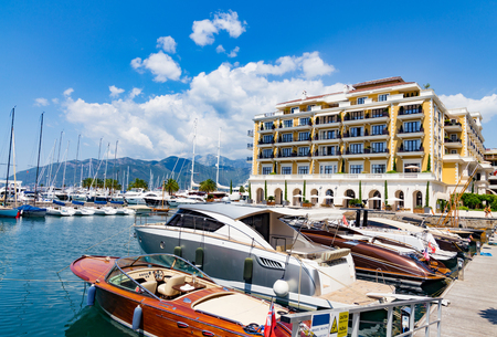Luxury waterfront homes for rent and sale, lively bars, wide range of sports, beautiful yacht, leisure and cultural activities in Porto Montenegro in Kotor Bay