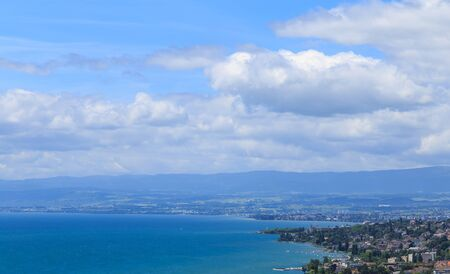 View on part of Lausanne city, beautiful blue sky and blue lake Leman. Lausanne Switzerand Stock Photo