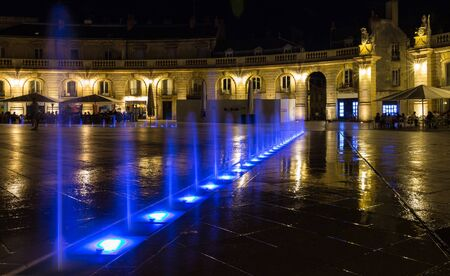 Liberation square with beautiful blue lightness fountain on the summer night. Bourgogne Franche-Comte province, Dijon France Stock Photo