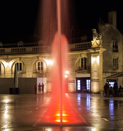 Liberation square with beautiful red lightness fountain on the summer night. Bourgogne Franche-Comte province, Dijon France Stock Photo