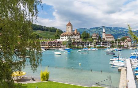 View on beautiful small city, lake Thun, marine and many boats. City of Spiez, canton Bern, Switzerland Фото со стока