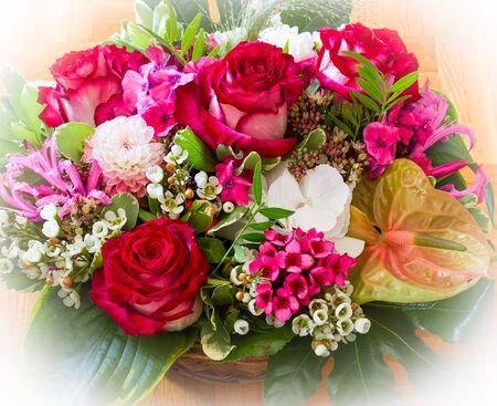Beautiful flowers in wooden basket handmade on wooden background. Vignette effect