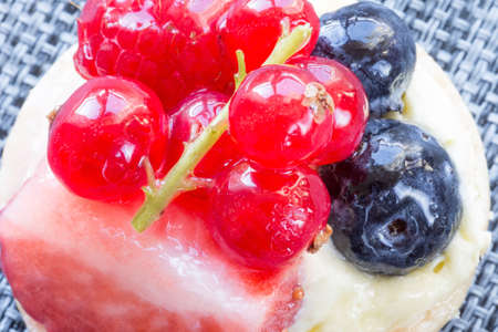 Sweet fruit cake with berries, raspberry, strawberry. Macro photography Stock Photo