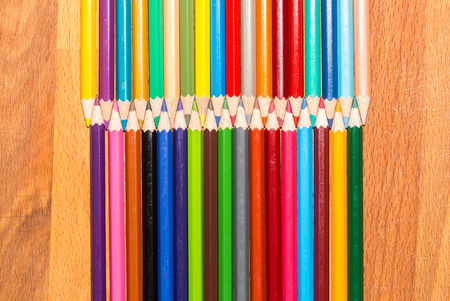 Color pencils isolated on the wooden background Stock Photo