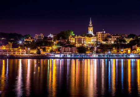 Night scene from Sava river of Belgrade downtown with Serbian orthodox cathedral. Belgrade dock