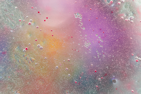 Abstract Colorful Backdrop With Oil Drops And Waves On Water Surface. Macro Photography