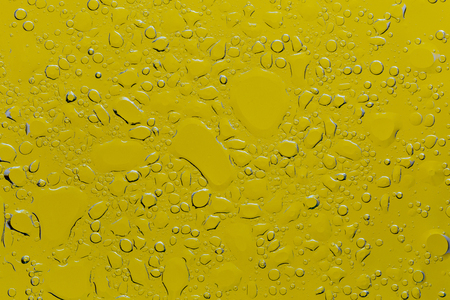 Yellow Water Oil Mixed Droplets Through The Glass. Macro Photography Stock Photo