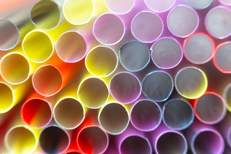 Group Of Plastic Straws For Drinks. Colorful Tubes. Abstract Background Stock Photo