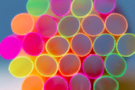 Group Of Plastic Straws For Drinks. Colorful Tubes. Abstract Background. Wet Glass Look Stock Photo