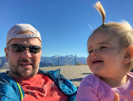 Father And Daughter On The Mountain At Sunny Autumn Day. Selfie Stock Photo