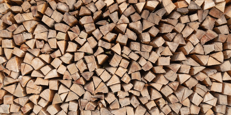 Firewood stacked in a woodpile Standard-Bild