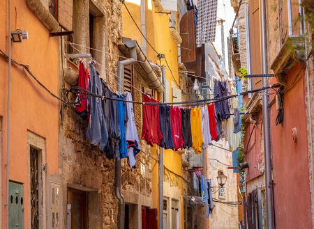 Narrow Street With Hanging Clothes-Rovinj, Croatia. Multicolored houses