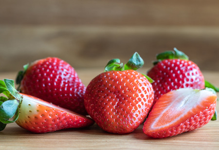 Sweetness Strawberry Fruits On The Wooden Background. Food Photography. Macro