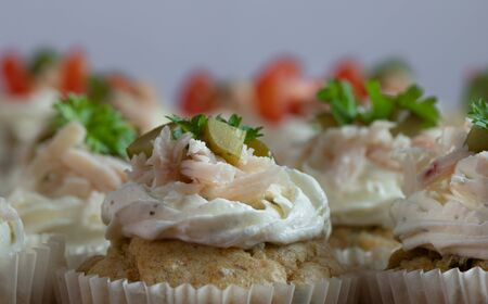 Delicious cupcakes with cream, persil leaves, and pickles. Food photography. Home made
