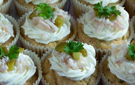 Delicious cupcakes with cream, persil leaves, and pickles. Food photography. Home made. Top view Stock Photo