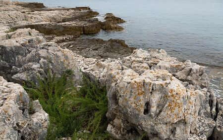 View on Adriatic sea at stormy day with big rocks.
