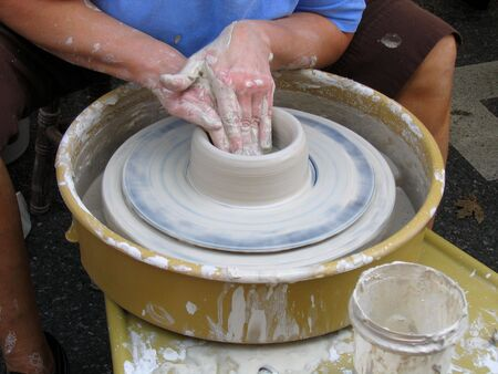 A Close-up Of A Potter Making A Bowl