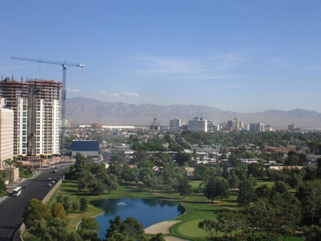an erection: A View of A Golf Course Next To A High-rise Under Construction In Las Vegas Nevada