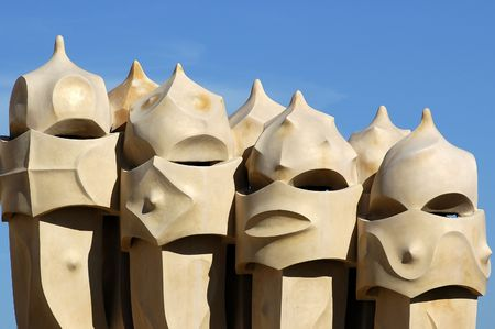 Face shaped chimneys on Gaudì Casa Pedrera Stock Photo
