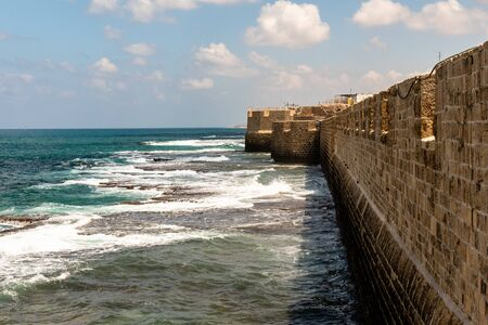 Sea and casle wall at city of Acre in Western Galilee, Israel