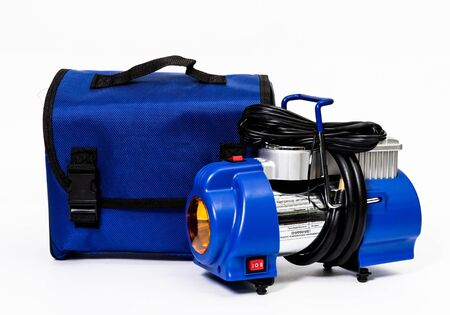 Car air compressor with bag isolated on white background Standard-Bild