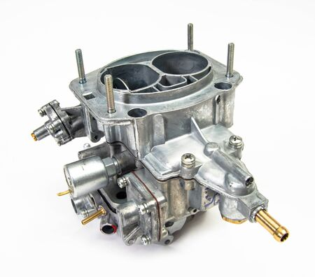 The carburetor of the internal combustion engine isolated on white background