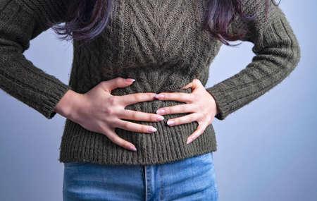 stomach pain girl Banco de Imagens - 151076100