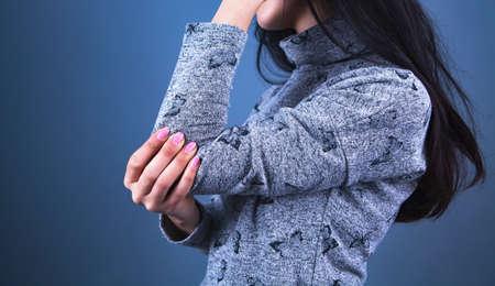 girl hand bone pain background. Banco de Imagens