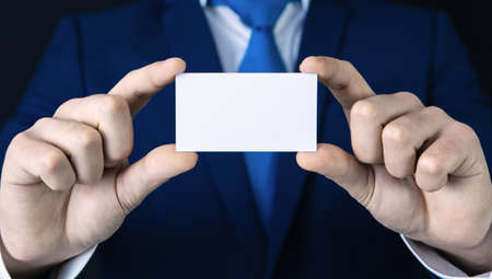 Businessman with a blank business card