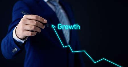 businessman on a black background with a growing arrow, growth chart, progress; business concept