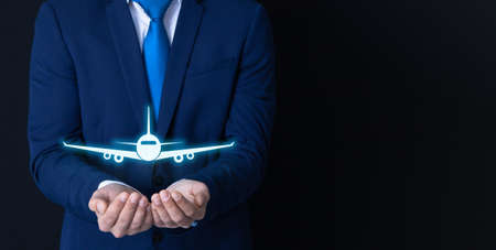 businessman and plane; business travel insurance