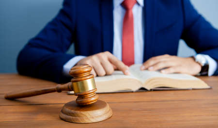 judge reads criminal code in sittings Reklamní fotografie
