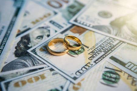 divorce wedding rings lie on the money